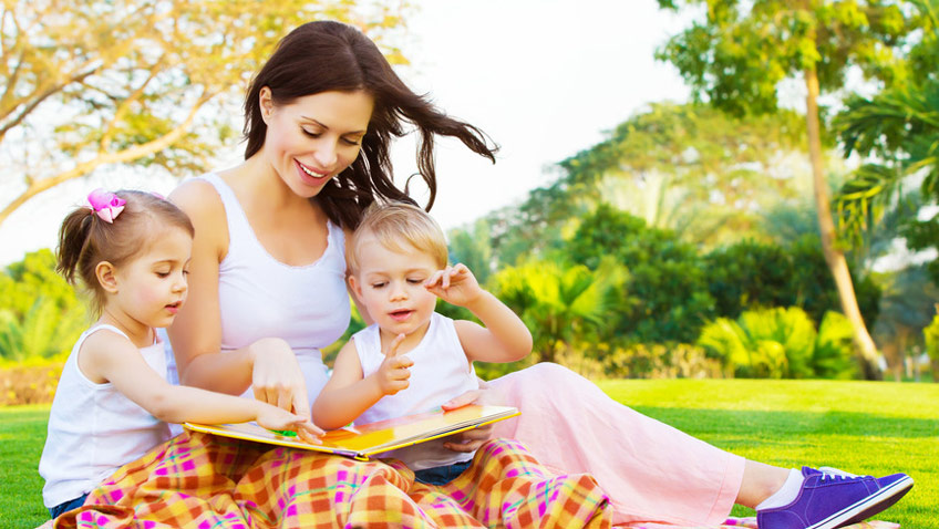 woman-with-daughter-and-son-read-fairytale-848x478